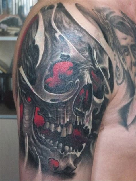 red skull tattoo skull on right half sleeve