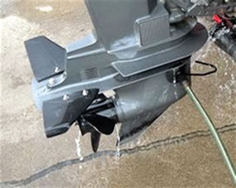 running boat motor with ear muffs tips on winterising outboard engines