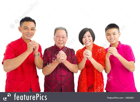 family celebrates with new years photo of asian family
