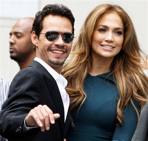 Trouble For Jlo And Marc by Poses For A Photo That Shows And Marc