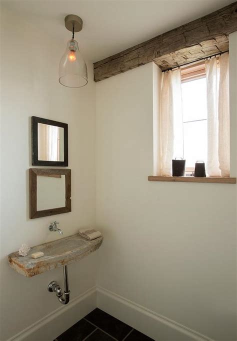 rustic powder room with concrete wall mount sink and