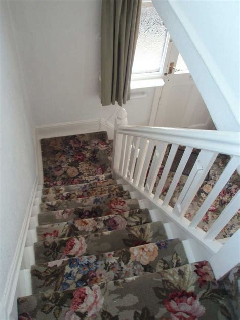 beautiful patterned carpet runner  stairs  flowers