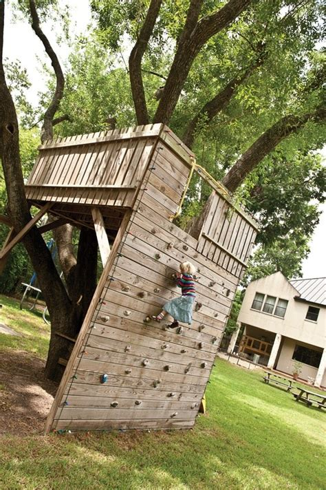 tree fort with climbing wall access how cool is this