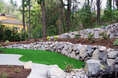 25 best ideas about boulder retaining wall on pinterest