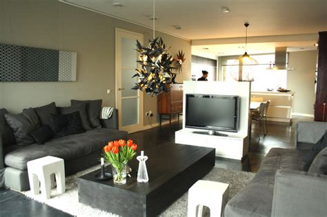 tv in the middle of the living room my houzz modern dutch home combines vintage and asian