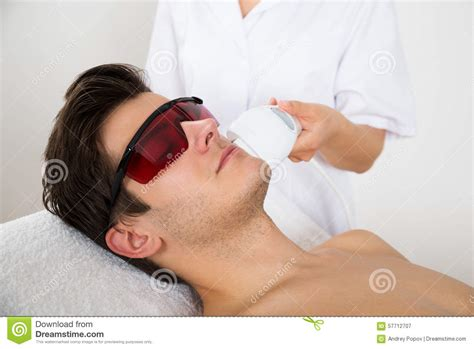 ipl hair removal clinic man receiving laser hair removal treatment stock photo