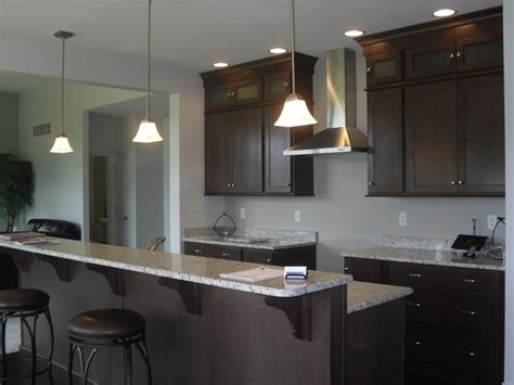 Copper River Cabinets by Kitchen In Buckboard Maple With Granite Tops
