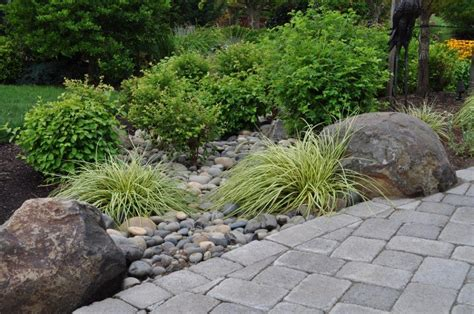 Way To Deal With Downspout Rock Bed To Divert Rain Water Rock Garden