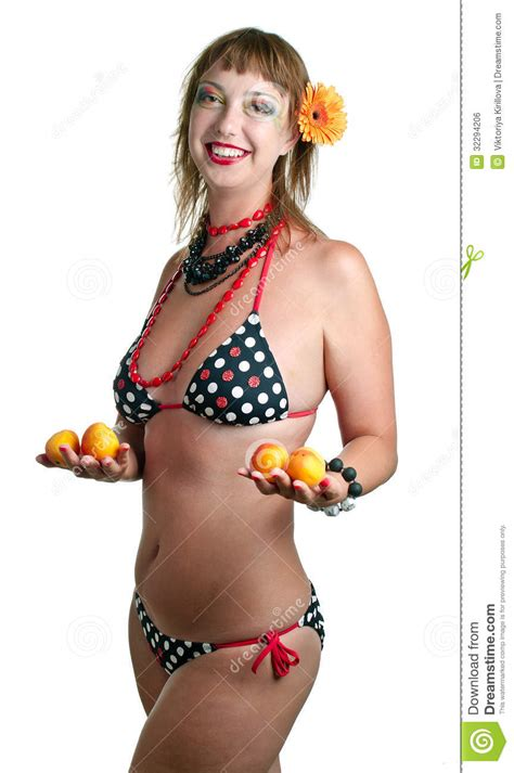 in bathing suit with apricots stock photo image