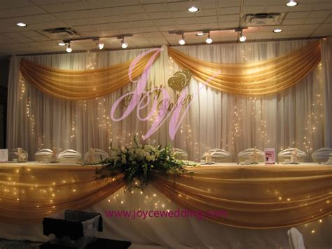 twinkle lights and gold sash backdrop decoration