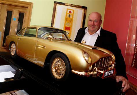 Bond Goldfinger Aston Martin 124 gold replica of bond s iconic aston martin db5 sold