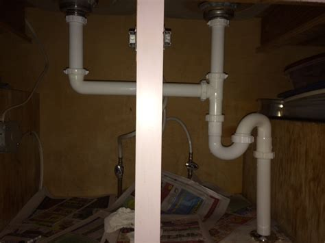 Double kitchen sink not draining right after plumbing