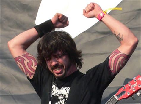can somebody explain dave grohl s tribal arm