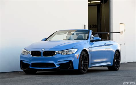yas marina blue bmw m4 convertible has a trunk wing
