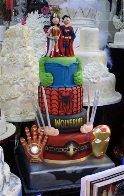 theme 4 tier wedding cake with superman groom toppers jpg hi res