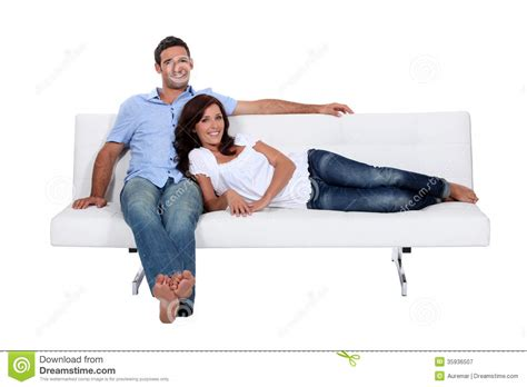 couple on sofa couple on couch stock image image of leaning back