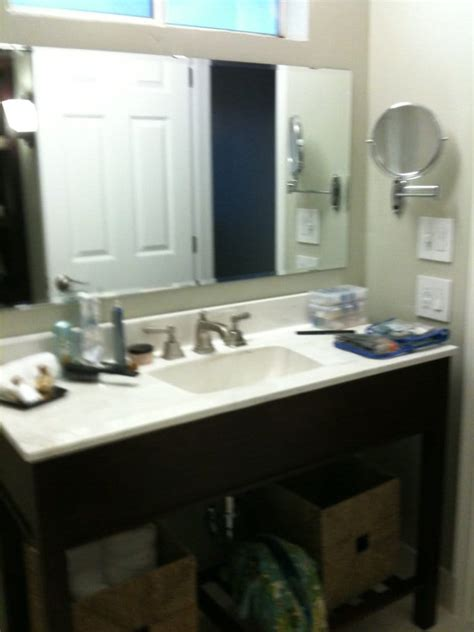 bathroom sink and counter magnifying mirror old