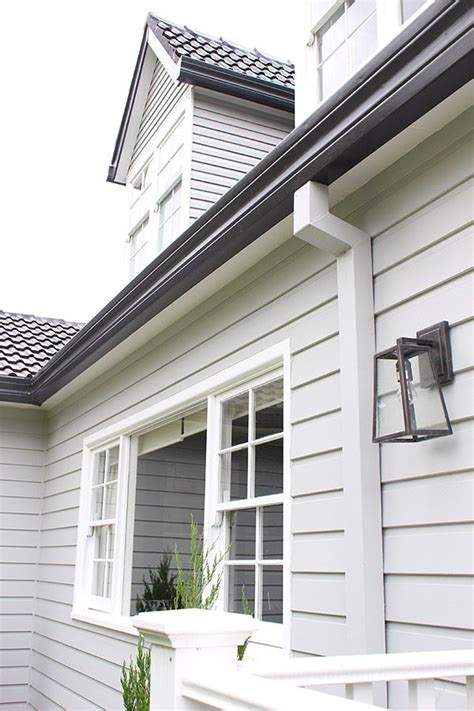 white weatherboard house roof gutters and fascia monument weatherboard milton
