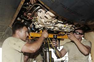 Jet Engine Mechanic by Photos