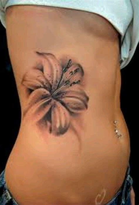 small tiger lily tattoo dragonfly and hibiscus via wren tattoos