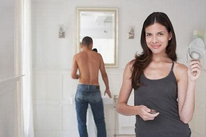 woman and man in bathroom 4 mens toiletry items women should use too