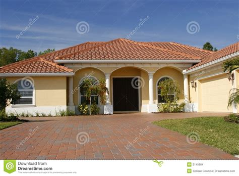 yellow house with roof neat yellow home with white columns tile roof and wide paved