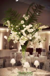 large floral centerpieces white floral centerpieces with large fern leaves for