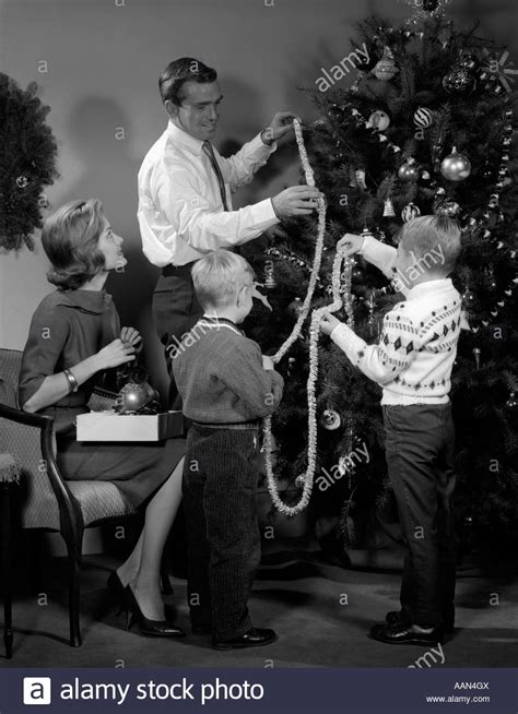most popular live christmas trees of 1960s 1960s family two sons trimming tree with stock photo royalty free image