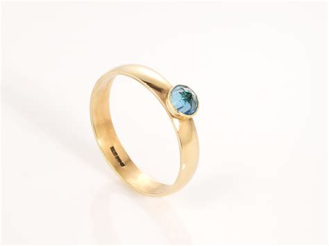 calling 9ct gold ring with blue topaz