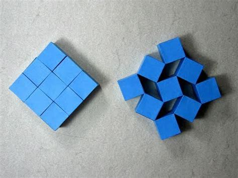 Movable Origami - origami wobbling wall of nine cubes heinz