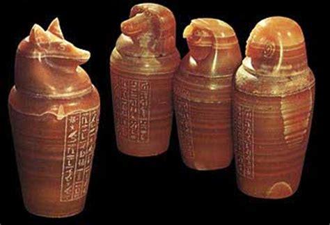 vasi canopi egizi vacca rossa vischio