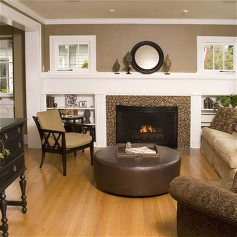 taupe with light oak floors and fireplace extended across wall with built ins painting ideas