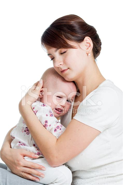 comforting a crying baby mother trying to comfort her crying baby stock photos