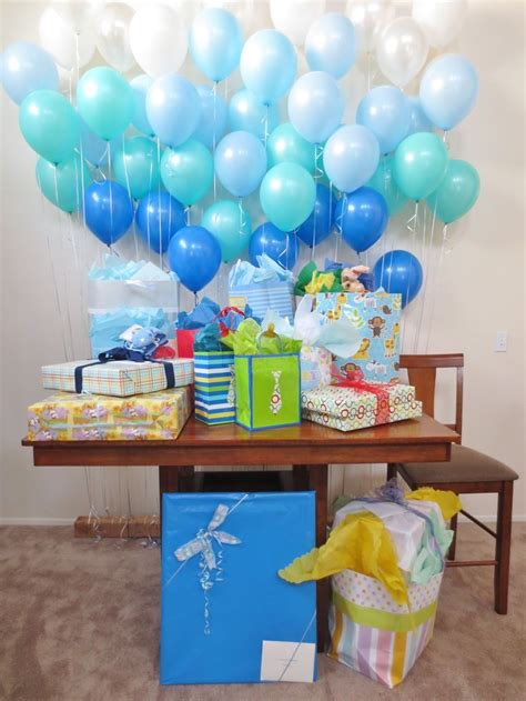 baby shower table tie single balloons behind a gift table or food table or