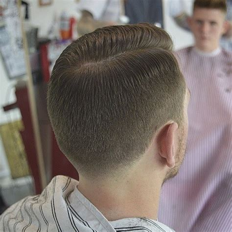 a medium haircut with side part and tapered in the back 40 latest side parted men s hairstyles
