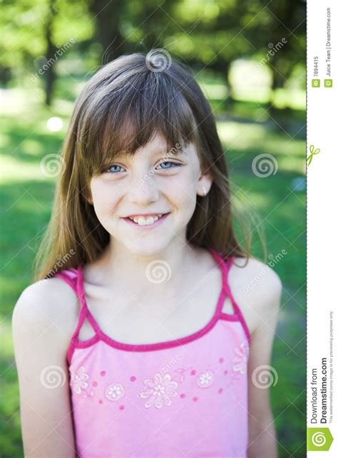 very young polska little friends portrait of little girl playing in the park royalty free