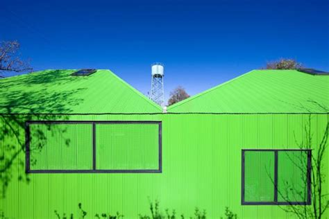 jetson green low cost prefabs land in santa monica escuela santa matilde is a fluorescent green prefab school