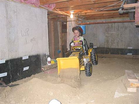 dirk the digger helps dig level the dirt in the basement