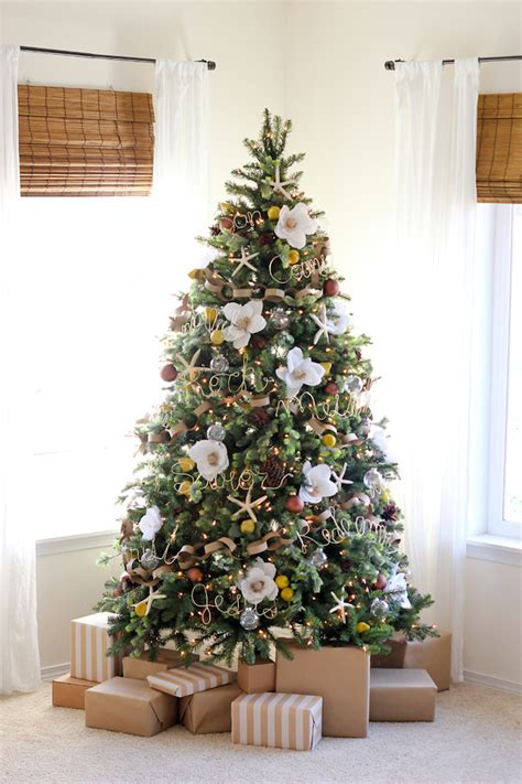 christmas trees are decorated with flowers instead of