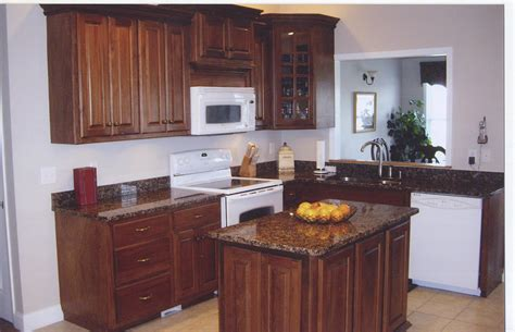 brown kitchen appliances granite countertop recent work and finished job