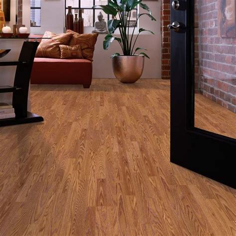 shop allen roth 7 5 in w x 47 25 in l gunstock oak laminate flooring at lowes com for
