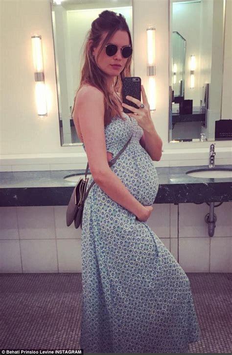 girl has baby in bathroom behati prinsloo posts precious snap of shannan click s tot stroking her baby bump