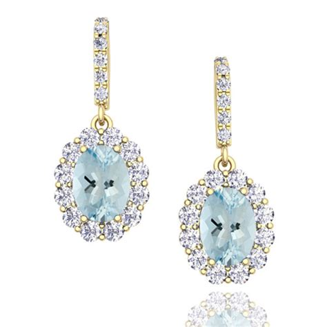 halo and aquamarine drop earrings in 18k gold 7x5mm