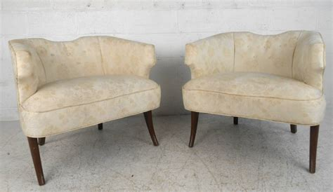 unique pair mid century modern sculpted back armchairs for
