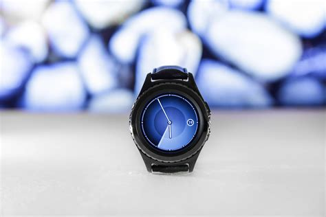 person holding black smartwatch  close  photography