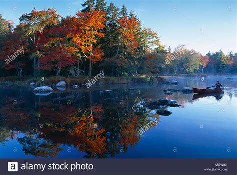 canoes nova scotia autumn mersey river with canoe nr kejimkujik national park