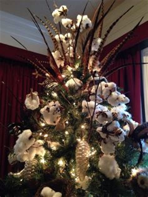 xmas floral decoration using cotton stalks quot southern poinsettia quot ornament made from the burr of the cotton boll