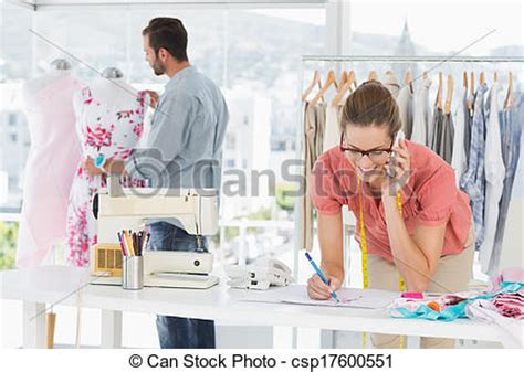 stock images of fashion designers at work in bright studio