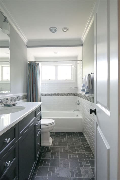 bathroom with grey floor tiny hall bath subway tile dark floors dark vanity