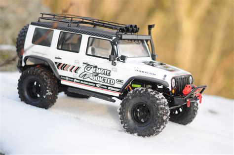 jeep wrangler rubicon rc on snowy rocks rc rctruck jeep wrangler axial